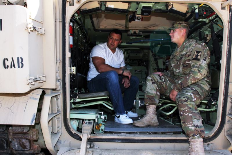 KC Chiefs player Mike Devito in Bradley Fighting Vehicle at Lenexa armory