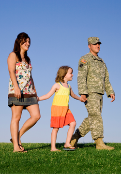 Soldier, wife and daughter walking together